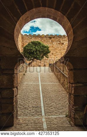 Gateway In Typically Moorish Style With A Cobblestone Ramp Leading To A Courtyard In The Castle Of T