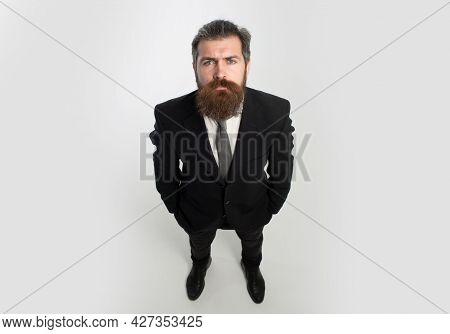 Funny Man, Businessman In Suit. Man In Formal Suit With Hands In Pockets Isolated Over White Backgro