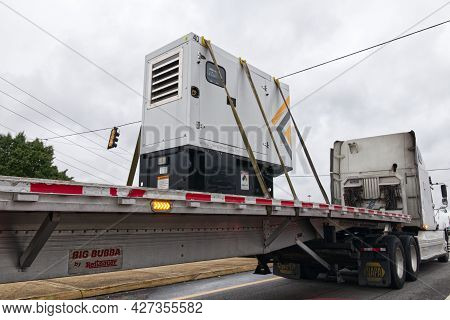 Columbia County, Ga Usa - 05 12 21: Semi Truck With Heavy Industrial Power Technology Cargo