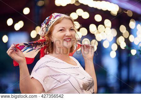 Smiling Mature White Woman Wearing Silk Headscarf.