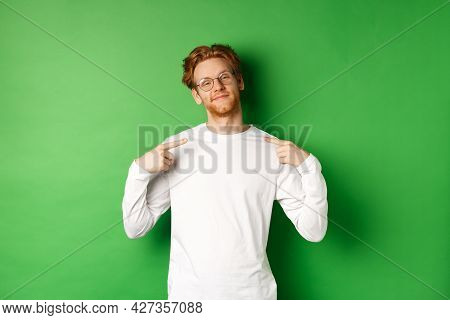 Confident And Smug Redhead Man In Glasses Smiling, Pointing At Himself Self-assured, Standing Over G