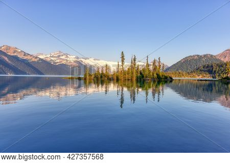 View Of Canadian Nature Landscape With Rocky Islands And Mountains In The Background. Garibaldi Lake