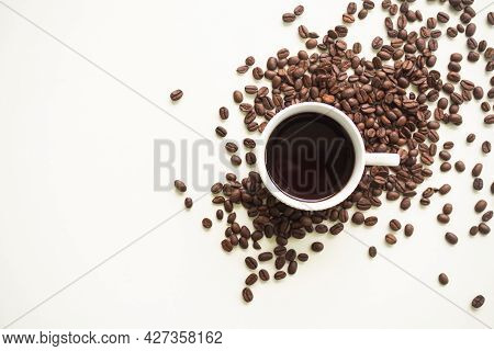 Espresso Hot Coffee In White Cup With Beans Coffee On White Table Background. Flat Lay With Copy Spa