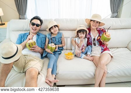 Asian Family Watch Tv Screen, Pretend On Beach During Summer In House. Happy Traveller People Having