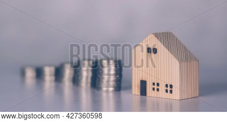 Stack Of Coin With Revenue And Saving Money For Real Estate And Success, Finance And Investment, Ins