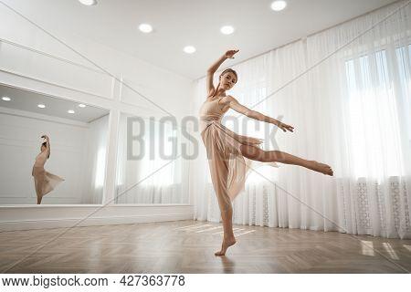 Beautiful Professional Dancer Practicing Moves In Studio