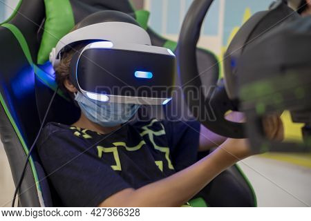 European Boy Kid Child Play Virtual Reality Game Wear Vr Glasses And Explore Alternative Reality. Cy