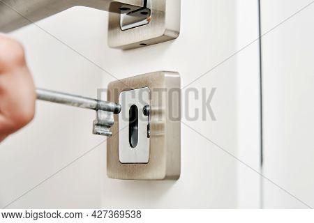 Woman Open Door Lock With A Key. Close Up Of Door Key In Keyhole