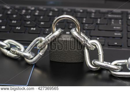 An Iron Chain Fastened With A Padlock On A Computer Keyboard The Concept Of Data Protection Censorsh