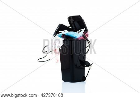 Trash Bin And Place For Text. Rubbish On A White Background And Space. Copy Space. Front View.