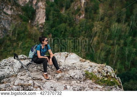 Hiking In The Mountains. A Trip To The Mountains. Tourist In The Mountains. Active Leisure Time Conc
