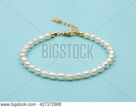 Luxury Elegant Baroque Pearl Bracelet On Bright Turquoise Textured Background. Close-up Shot.  Selec