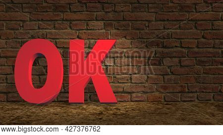 Ok Red Lettering On The Sandy Ground Leaning Against A Dark Brick Wall - 3d Illustration