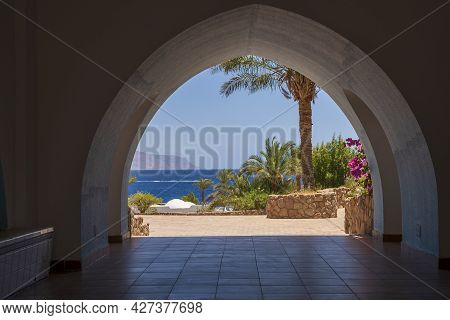 Beautiful Arched Doorway In A Building On The Shores Of The Red Sea At Morning In The Resort Town Of