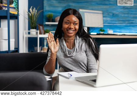 Afro American Student Waving Academic Collegue During Online Videocall Meeting Conference Using Lapt