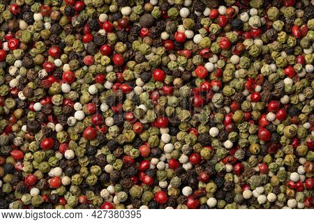 Mixture of peppercorns full frame close up as a background