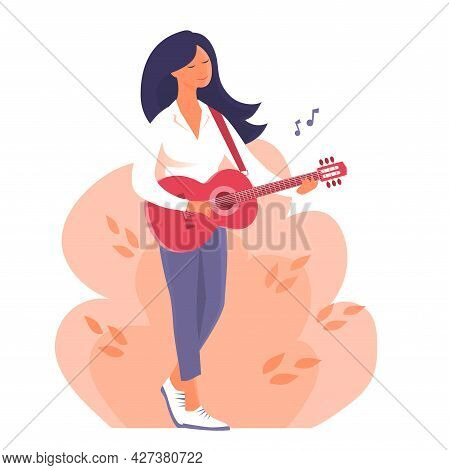 A Young Woman Stands And Plays The Guitar. Classical Musical Instrument. Fun Mood. Leisure Activitie