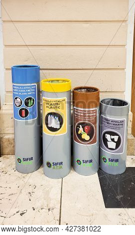 Separate Trash Bins For Recyclable Types Of Garbage At Airport Antalya. Cylinder Shaped Trash Cans O