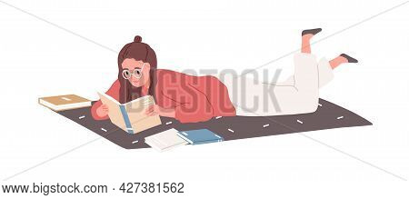 Young Woman Lying And Reading Books At Home. Student Studying And Preparing For Exam With Textbooks.