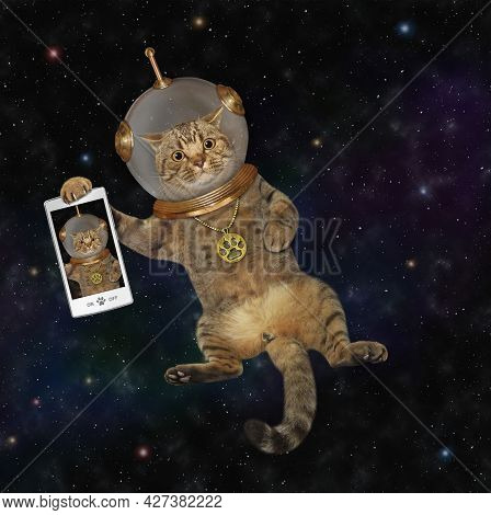 A Beige Cat Astronaut Wearing A Space Suit With A Smartphone Is In Outer Space.