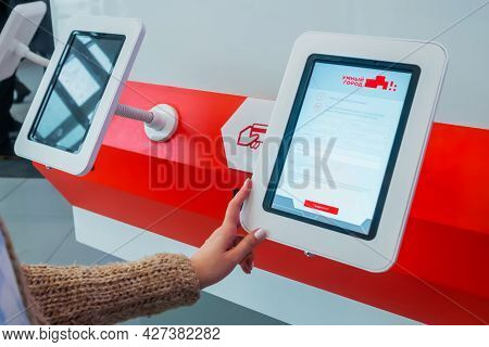 Moscow, Russia - June 05, 2019: Technology Exhibition. Close Up: Woman Hand Using Vertical Informati
