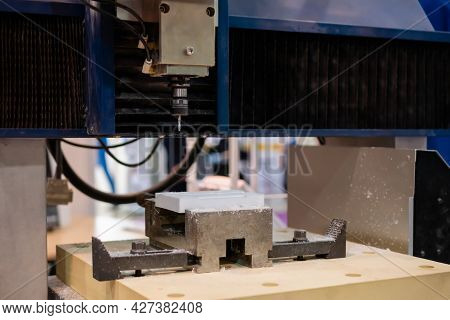 Turning Milling Machine Cutting White Acrylic Artificial Stone Workpiece At Factory, Exhibition. Sto