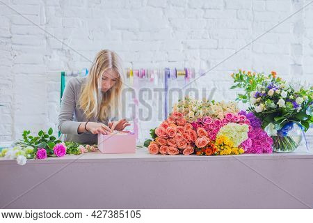 Professional Woman Floral Artist, Florist Making Gift Box With Flowers On Table At Workshop, Flower