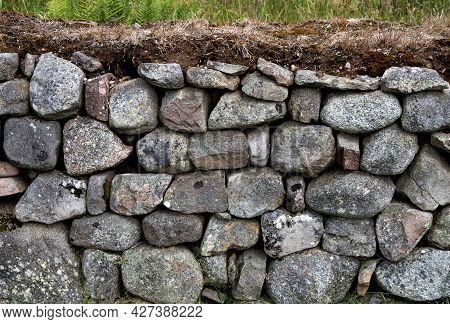 Wall Made Of Boulders And Turf In A Country Location