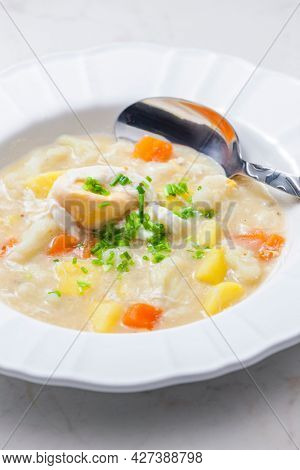 cauliflower soup with carrot, potatoes and poache egg