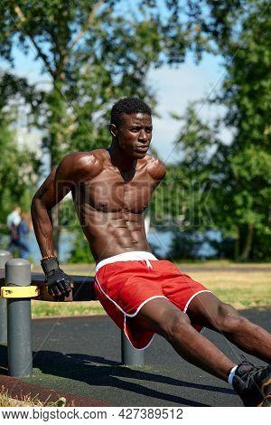 Athlete Doing Push-ups On The Sports Ground, African American Athlete Doing Push-ups On Outdoor Gym