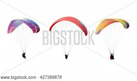 Collection Bright Colorful Parachute Isolated On White Background,  The Sportsman Flying On A Paragl