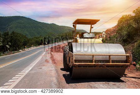 Roller Rolling Fresh Hot Asphalt On The New Road. Road Construction. Road Roller At Road Constructio