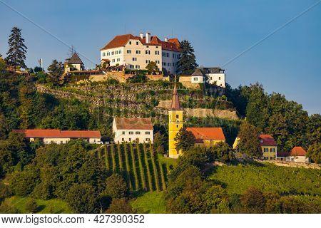 Kapfenstein castle and church with vineyard, Styria, Austria