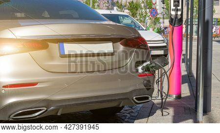 Electric Car. Recharge Fuel Technology With Cable To Power Battery. Eco Green Energy Hybrid Vehicle
