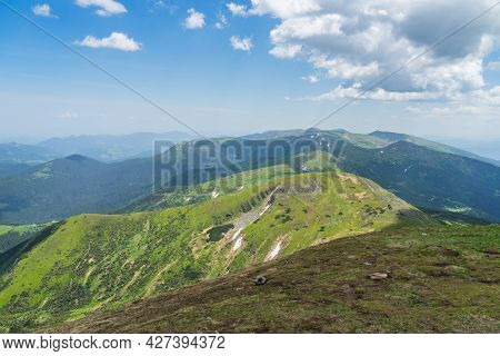 A Beautiful View From Hoverla In The Carpathians To The Mountains Against The Background Of The Sky.