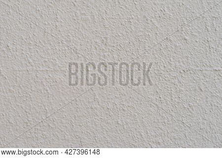 Painted Rough Plaster Wall, Light Gray Color, Scratched Surface, Background