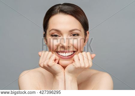 Young Beautiful Woman With Perfect Skin, Touching Her Face And Smile. Cosmetology, Beauty And Spa Co