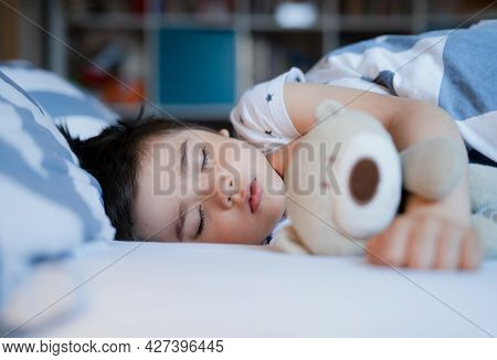 Cute Boy Sleeping On Bed With Morning Light,lovely Child Get Deep Sleep While Taking A Nap,kid Relax