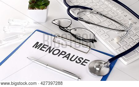 Menopause Text On White Paper On The White Background. Stethoscope ,glasses And Keyboard