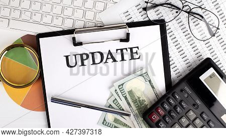 Text Update On Office Desk Table With Keyboard,dollars,calculator ,supplies,analysis Chart On The Wh