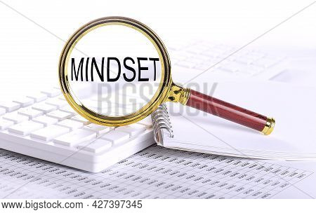 Mindset Word Through Magnifying Glass On Keyboard On Chart