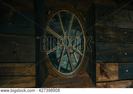 Soft Focus Vintage Circle Shape Window In Old Pagan Wooden Church Building