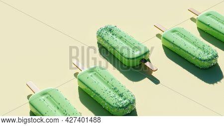 Apple green popsicles background. Fruity ice pop, ice cream treat