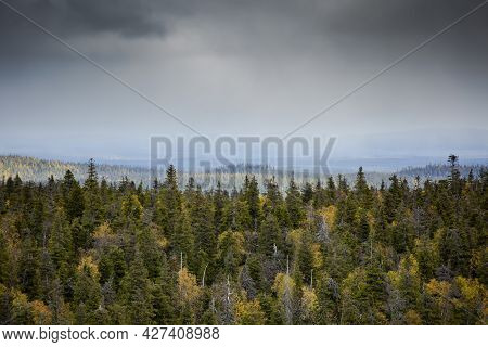 Dramatic Finnish Autumn Landscape With Colorful Forest In The Foreground