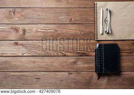 Still Life Of Office Workspace With Supplies. Flat Lay Old Vintage Desk With Organizer Notebook And