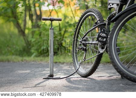 A Pump And A Bicycle. Bicycle Repair In The Forest. Close Up