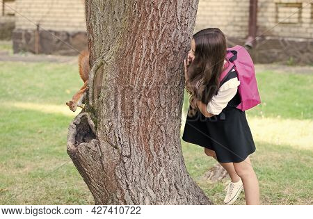 Study Nature, Not Books. Little Child Look At Squirrel Climbing Tree Trunk. Nature Class In Park. An