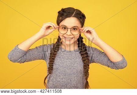Clever Girl. Girl School Pupil Wear Eyeglasses Yellow Background. Adorable Nerd. Schoolgirl Concept.