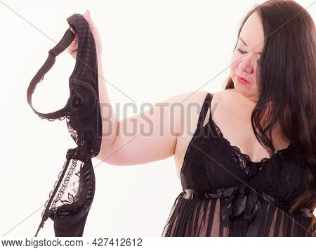 Plus Size Fat Mature Woman Wearing Lingerie Holding Full Cup Bra, On White. Bosom, Brafitting And Un