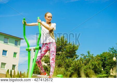 Girl Training On Public Equipment